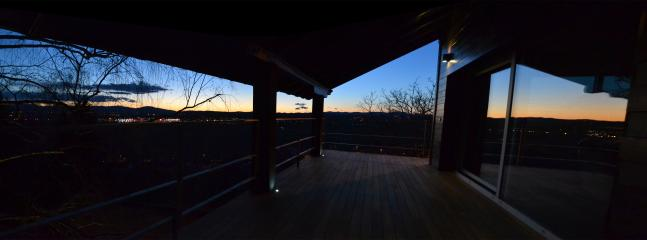 First floor wood deck terrace by sunset