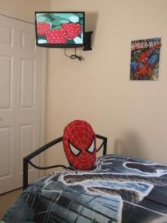 The Spiderman themed twin bedroom with flat screen TV and fitted wardrobes.