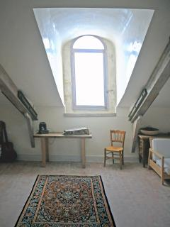 penthouse internal view with the large provencal dormer window bathed in light