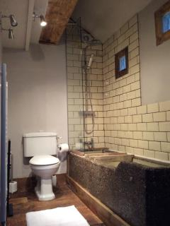 Cowshed bathroom and over bath shower