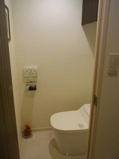 Toilet with washlet and seat warmer