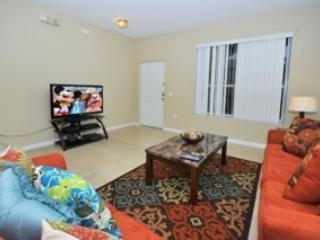 Living room with large flat screen TV and DVD player