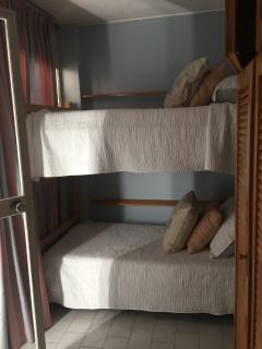 Third  bedroom with bunk beds and a bathroom