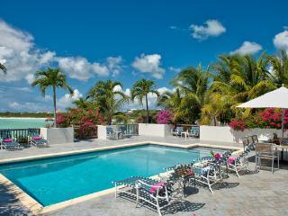 Plantation- style villa in Ocean Point, ocean views with eclectic safari décor. TNC VUX, Turks and Caicos