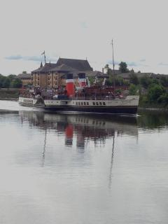 Waverley- the world's last seagoing paddle steamer passing by.