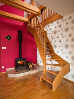 The fireplace for cold days... Stairs lead to a mansard roof with 2 beds and a reading corner.
