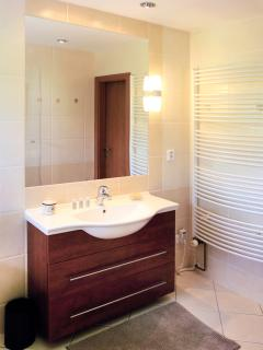 7 m² big, shower cabin, bathtub, washing-machine, hair dryer. A separate toilet is right next to it.