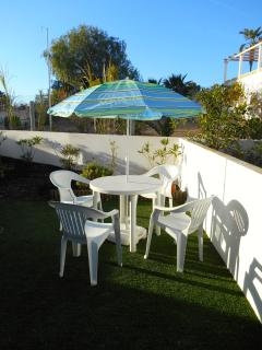 Garden with patio dining area, 2 sun loungers and BBQ