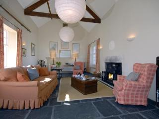 North Pembrokeshire Arts & Crafts home - sitting room with slate floor and log burning stove
