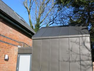 The modern extension clad in black zinc (courtesy of our architects vision!)