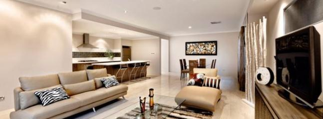 Large living, dining and kitchen area