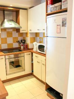 Kitchen with dishwasher, microwave and full cooking facilities.