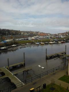 View from apartment of upper harbour, moorings, town and out to sea.