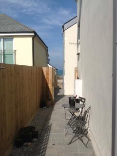 Property enjoys side and rear patio areas. From the side you can enjoy views down to the sea.