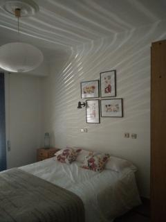 Dormitorio con cama 150m