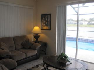 Living Room with pool and lake view
