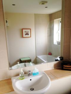 The main bathroom with large mirror and retro radio if you like to sing whilst you shower.