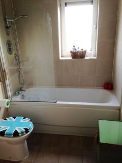 The main bathroom has a shower and full size tub.  Enjoy a candle light bath with music.