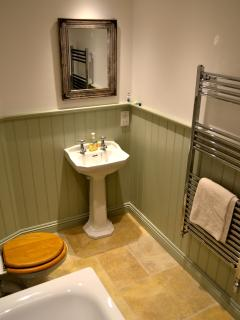 bathroom 1/ bath , toilet and sink
