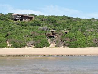 Hub building above and beach house nestled in the dune forest below