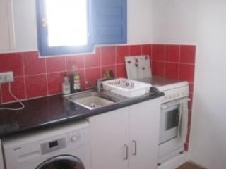 Kitchen with full size cooker and washing machine and all utensils.
