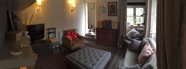Homely Sitting room with wood burner TV/DVD and on demand TV Wifi