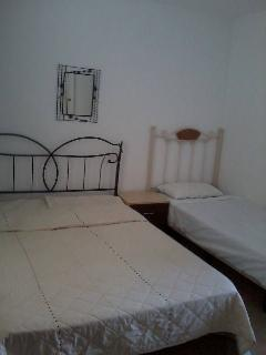 Upstairs bedroom - double + single bed