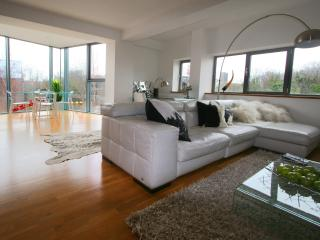 Large open-plan living, with exceptional views over the canal & nature reserve.