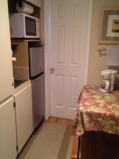 Kitchenette - microwave, crock - pot, coffee pot, frig/frez, sink area & kitchen supplies.
