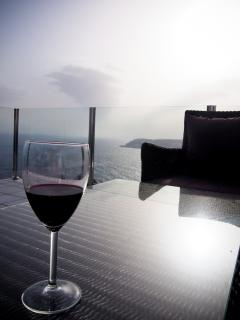 Enjoy the Salobrena's sunset over glass of wine