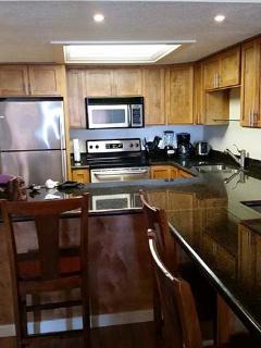 Full size kitchen with updated appliances.
