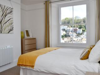 Bedroom 1, with Kingsize bed, wardrobe, bedsides tables and chest of drawers & amazing views