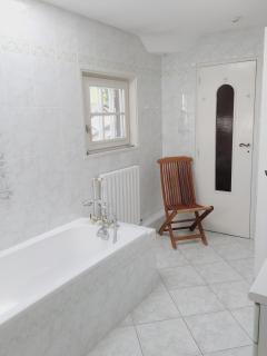 1st floor bathroom with shower and bath