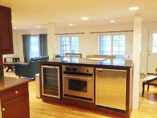 Looking at the Living Room From Kitchen across Kitchen Island with Stainless steel Appliances