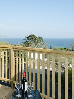 Enjoy a glass of wine on the terraced deck area.