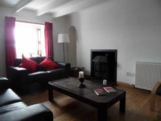 The lounge area has seating for six and a log burning stove for that cosy evening in