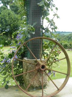 Rustic cart wheel clematis and roses