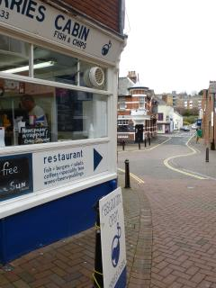 Cowes High Street chippy with cottage in the distance.