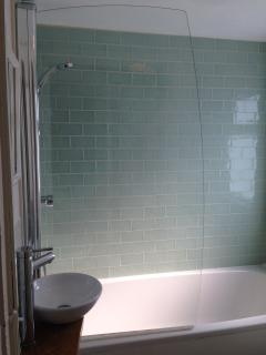 Compact but pretty and stylish bathroom incorporating bath, shower over, basin and WC