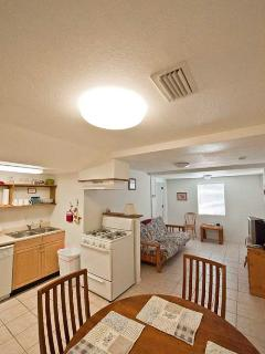 Large dining area, full kitchen, with stove and large fridge with freezer.