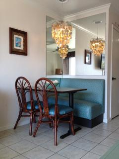 Banquette Dining with Shell Chandelier