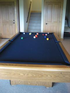 Ball return pool table in lower level game room.