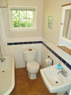 Updated bathrooom with claw foot tub/shower