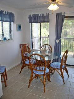 Dinning Area (seats 6) with a Second Set of Sliding Glass Doors to the Balcony