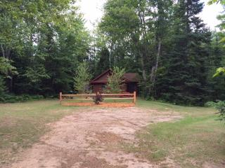 Front view of Tuckaway coming down path to cabins