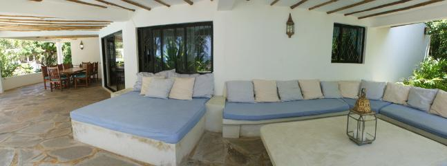 An extra double bed as part of the outside seating.