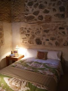 Bedroom, bed 135 , wardrobe, original walls sixteenth century.
