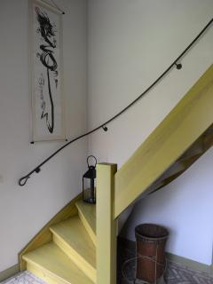 staircase to the first floor (bedroom 3, bathroom and extra bed