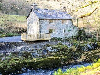 PEN Y BONT, pet-friendly riverside cottage, beams, woodburner, ideal touring bas