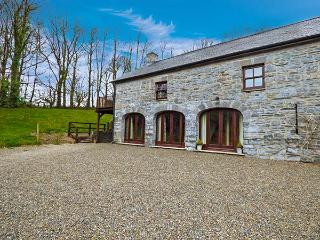 THE COACH HOUSE, stone barn conversion, woodburner, off road parking, garden